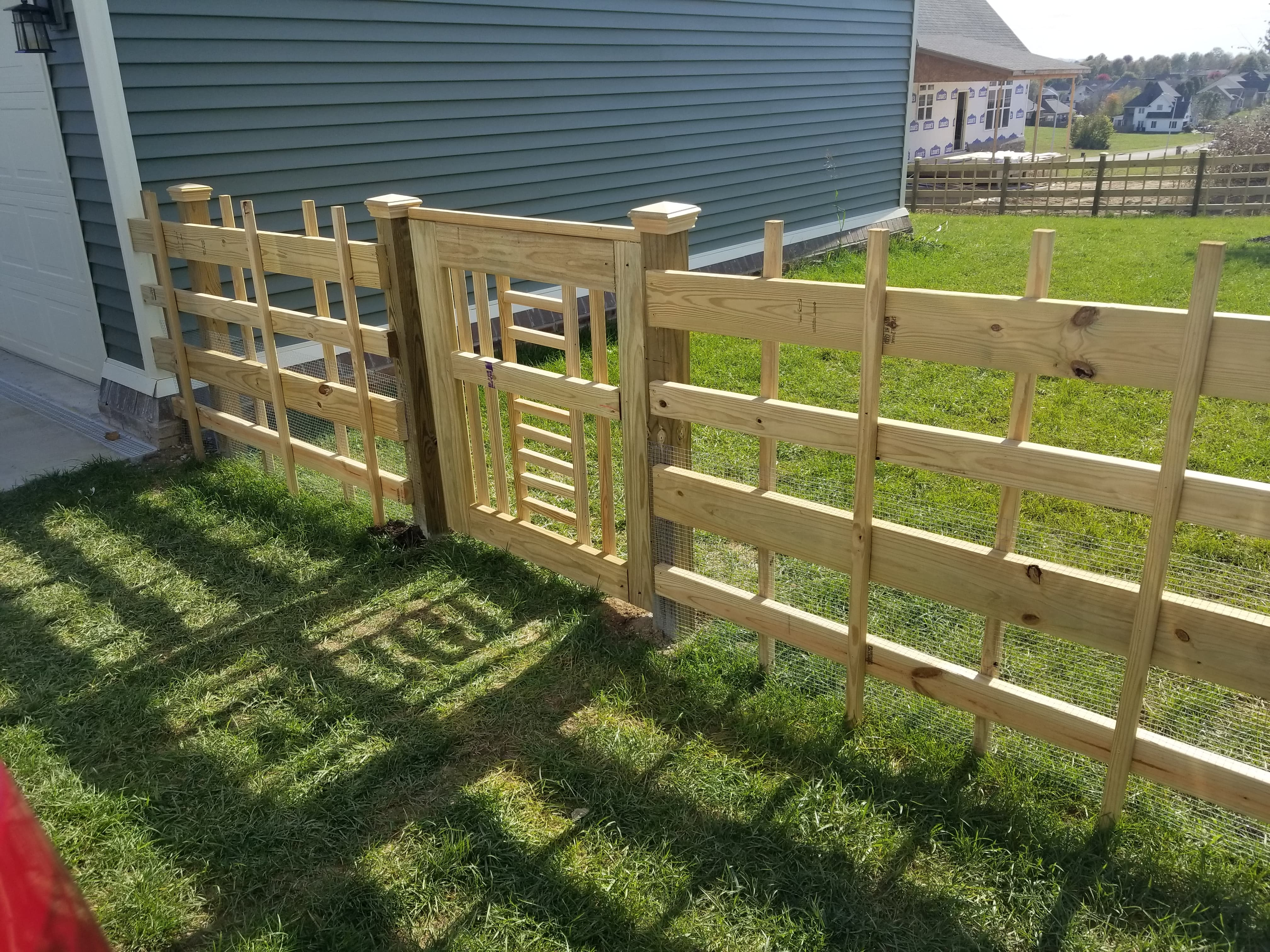Custom Wood Fence with Custom Gate and Wire insert